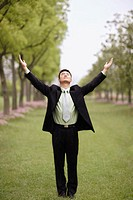 Businessman with Raised Arms