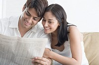 Happy Couple Checking Stock Listings