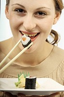 Woman eating sushi.