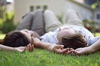 Couple relaxing on their lawn