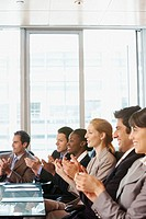 Businesspeople clapping during a meeting