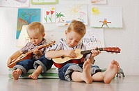 Boys playing with guitars