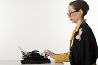 Woman Typing on Antique Typewriter
