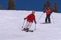 A brother and sister skiing spring snow at Diamond Peak, NV.