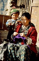 Mother & daughter, Taming Tribe, Lantang Trek, knitting together outdoors.