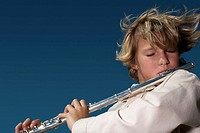 Boy Playing a Flute