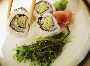 Avocado rolls and chopsticks, close-up