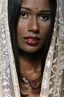 Woman with bindi on forehead wearing shawl, portrait