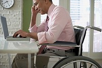 Businessman in Wheelchair Working on His Laptop