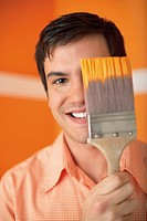 Man Painting a Room Orange