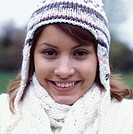 Young woman wearing warm clothing, smiling, close-up, portrait