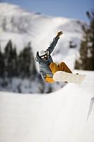 Snowboarder Grabbing Heel Edge in Halfpipe