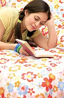 Teenage Girl Reading Novel