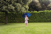 Girl under Umbrella in Rain