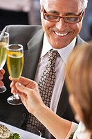 Businesspeople Clinking Champagne Glasses