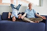 Grandfather Meditating with Girl Playing Around