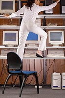 Businesswoman in Front of Computers