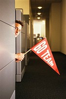 Man in Office Holding Pennant
