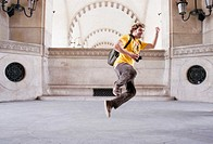 France, Paris, Young man jumping, portrait