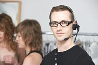 Man wearing headset backstage at fashion show, portrait
