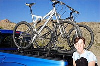 Woman Posed Beside Mountain Bikes