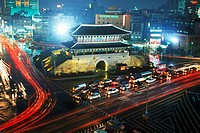 Tongdaemun East Gate at night with traffic in Seoul