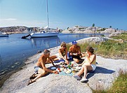Four Swedes having picnic at Storra Nassa island froup in Stockhom Archipelago