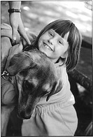 Young girl hugging dog