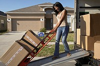 Woman Unloading Moving Van