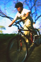 Blurred image of a mountain biker going down a hill