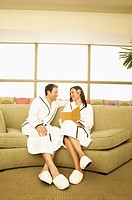 Couple Reading Book at Spa