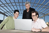 Three Young Men Admiring Laptop