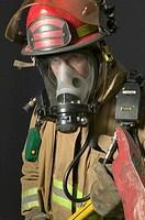 Fireman wearing oxygen mask, holding axe