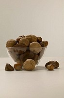 Mixed nuts in bowl, studio shot