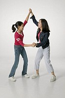 Two teenage girls (14-15), wrestling in studio