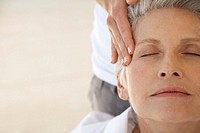 Middle Aged Woman Having Temples Massaged
