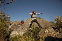 Hiker Jumping to Large Rock (thumbnail)