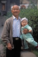 Proud senior man holding child, portrait, expressions, family ties, heritage, Chongqing, China, Asia, 041603