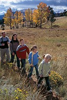 Family of five hiking in fall-colored meadow, Rocky Mtn Nat´l Park, CO