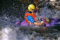 Man kayaking in whitewater on the Big Thompson River near Estes Park, CO
