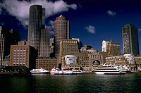 Boats and office buildings at the Water Front, Boston, Massachusetts.