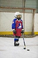 6 year old boy playing hockey.  MR-0435