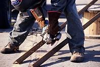 Man grinding steel..