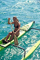 Polynesian woman on outrigger canoe, Hawaii