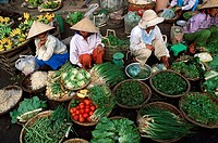 High angle view of vendors sitting in a vegetable market, Vietnam