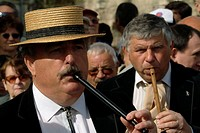 Close-up of two mature men blowing recorders, Provence, France