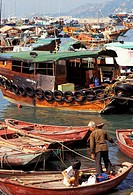 Hong Kong, many different shapes and sizes of old fishing boats tied together NO MODEL RELEASE