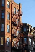 Fire escape, late afternoon sun, on a Boston's Back Bay townhouse. USA