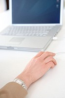 Woman´s hand on computer mouse