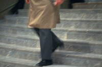 Businessman walking down the stairs, high angle view, blurred motion, New York City, NY, USA